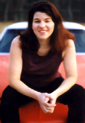 Leila_sitting on car.jpg (47138 bytes)